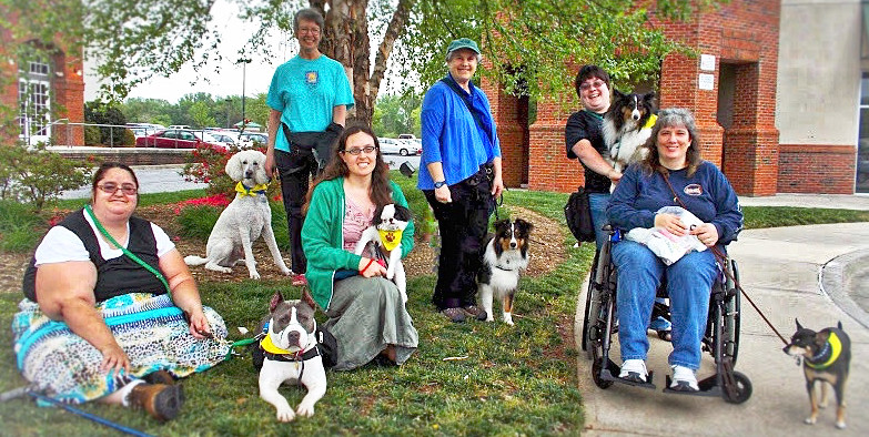 Many posing, each with a psychiatric service dog