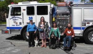 PSDP board members in front of fire truck