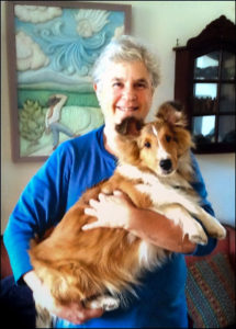 Elaine holding Sheltie Yvie in her arms